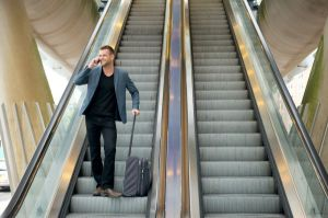 man walking on an escalator
